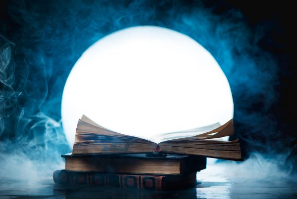 An open book of spells in full Moon. Reader imagination and writing inspiration concept with copy