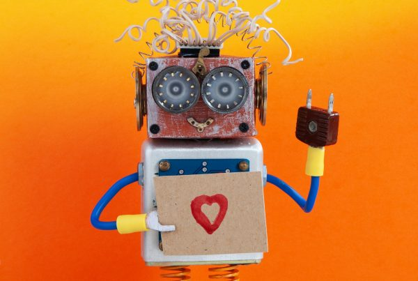Robot holds greeting card love heart symbol. Valentines day romantic message
